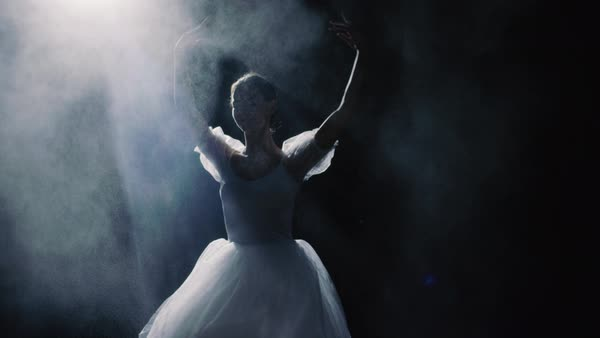 Mid shot of a beautiful young ballerina spinning gracefully in the spotlight Royalty-free stock video