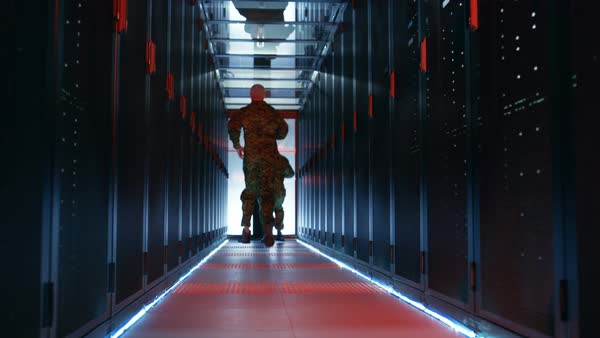 Security alarm with flasher triggered in data center. Two military men running in the corridor full of server racks. Royalty-free stock video