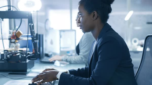 Black female scientist working on a computer with her colleagues at research center Royalty-free stock video