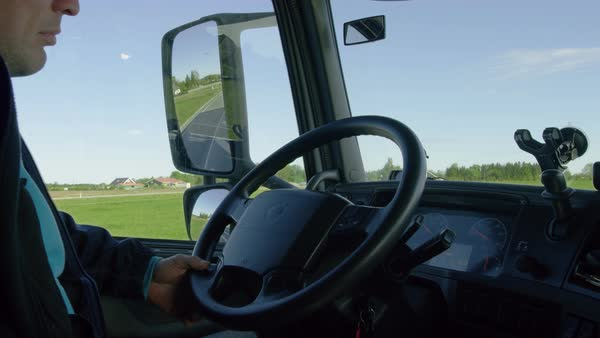 Inside of the cabin view of the professional truck driver driving his big vehicle on the road Royalty-free stock video