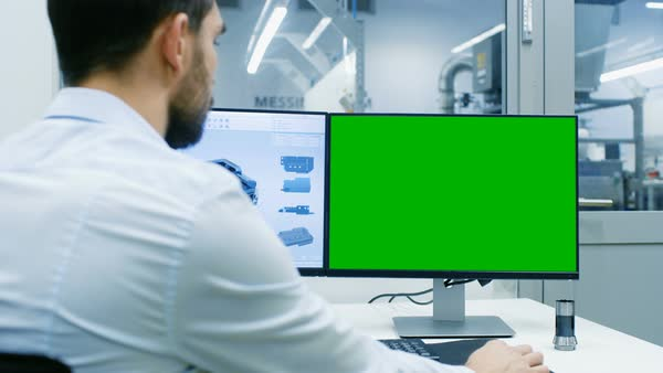 Engineer working on a personal computer with two displays designing new efficient engine in CAD program Royalty-free stock video