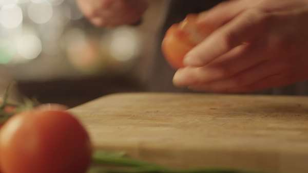 Professional chef is rapidly chopping tomatoes in kitchen Royalty-free stock video