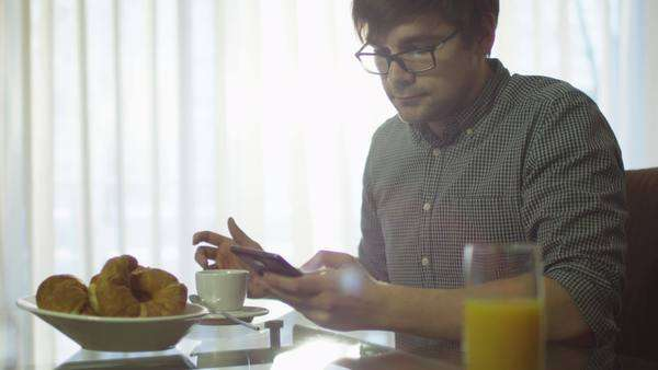 Man have a breakfast and using phone at home Royalty-free stock video