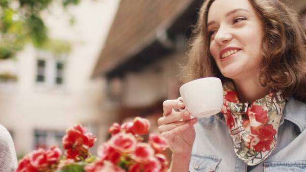 Happy young people are talking in outdoor coffee shop Royalty-free stock video