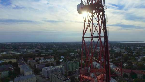 Aerial drone shot of a telecommunication radio tower mast in residential area. Royalty-free stock video