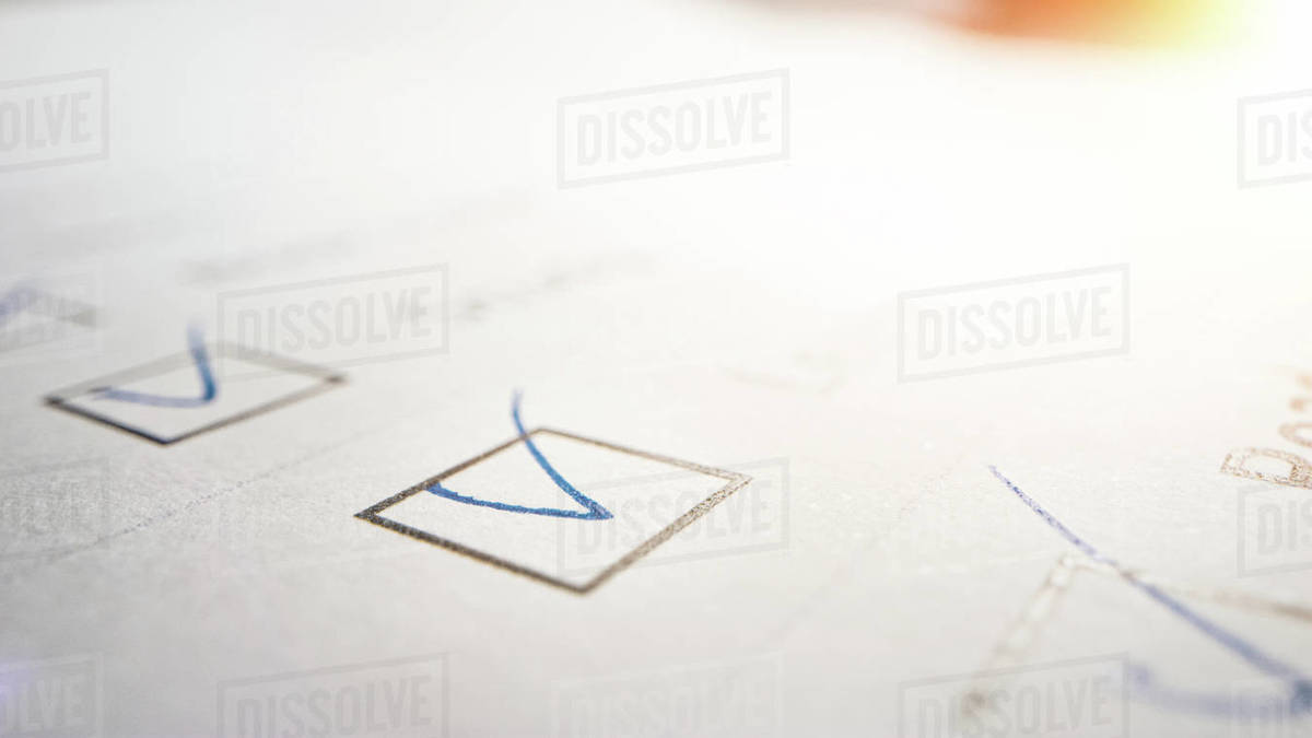 Person Ticks Checkbox Marks with a Pen, filling up To Do List. Checking Marks and FIlling in a Task List / Questiannaire / Medical Cart. Moving Macro Close-up Camera Royalty-free stock photo