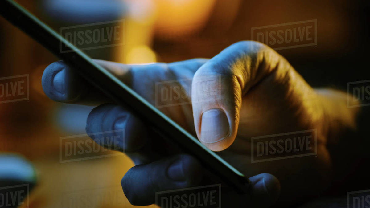 Person Holding Touch Screen Smartphone Device and Typing Message. Concept of Email Writing, Chatting in Social Media Apps, Sending an SMS, Taking Note. Close-up Macro Side View Royalty-free stock photo
