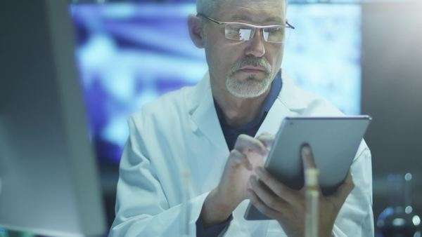 Scientist is using tablet in laboratory Royalty-free stock video