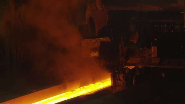 Heavy industry machines processing melted burning hot metal bar. Royalty-free stock video
