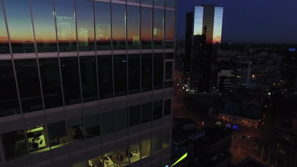 Aerial drone shot of an evening business downtown city landscape with glass buildings. Royalty-free stock video