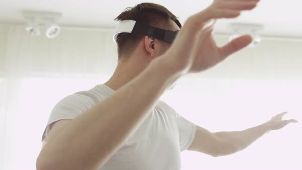 Man wearing vr headset at living room. using gestures with hands. Royalty-free stock video