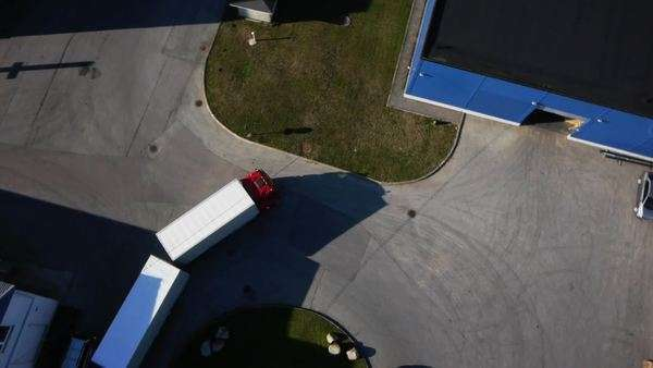 Truck is driving to logistics center, aerial shot Royalty-free stock video