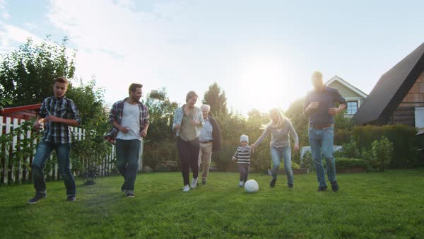 Family Paying Football in the Backyard. Royalty-free stock video