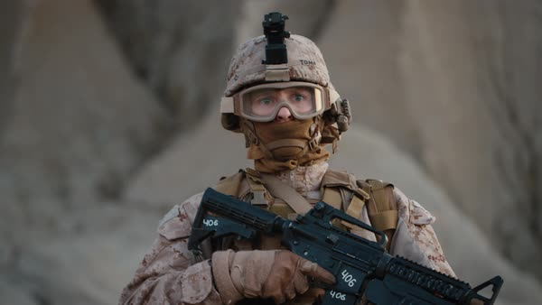 Portrait of Fully Equipped and Armed Soldier Wearing Safety Glasses in Desert Environment Royalty-free stock video