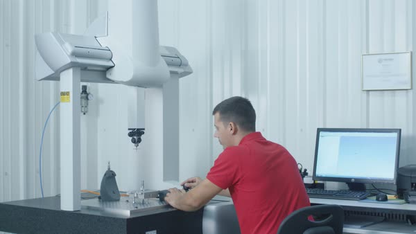 Engineer sets up and uses coordinate measuring machine (cmm). Royalty-free stock video