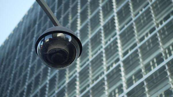 Close up of a security camera with the European Commission building as background. Royalty-free stock video