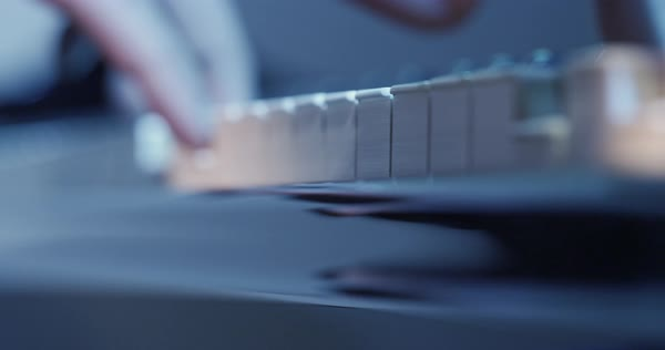 Panning shot of a person playing a piano Royalty-free stock video