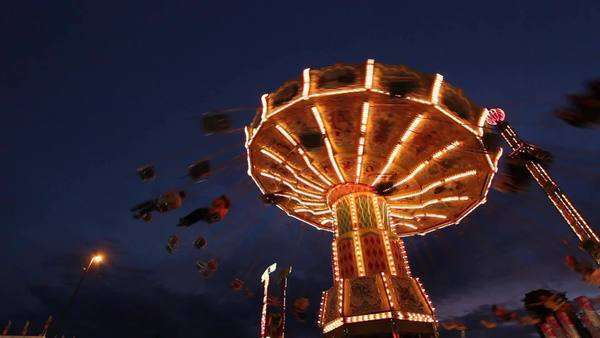 Low angle of carnival swings at night Royalty-free stock video