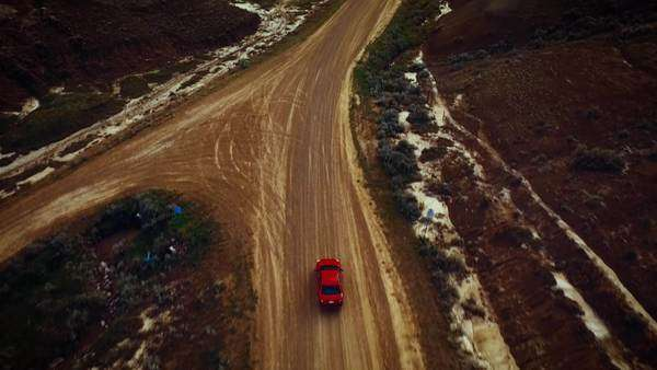 Aerial shot of car driving on an open road Royalty-free stock video