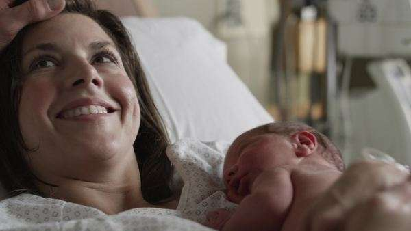 Close-up mother holding newborn baby (0-1 months) in hospital / Payson, Utah, USA Rights-managed stock video