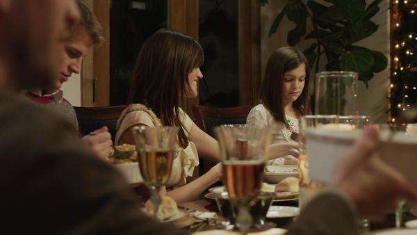Medium shot dolly shot family with children (2-5 months, 2-9 years) having Christmas dinner / Cedar Hills, Utah, USA Rights-managed stock video