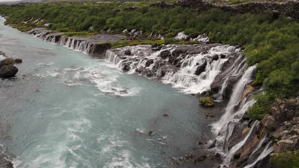 Wide high angle shot of waterfalls pouring into river Royalty-free stock video