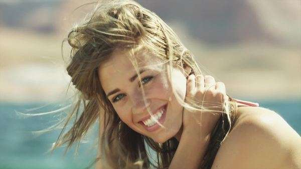 Close-up portrait of smiling young woman near Lake Powell, Utah Royalty-free stock video