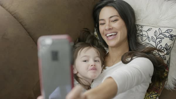 Close up of mother and daughter making faces for selfie Royalty-free stock video