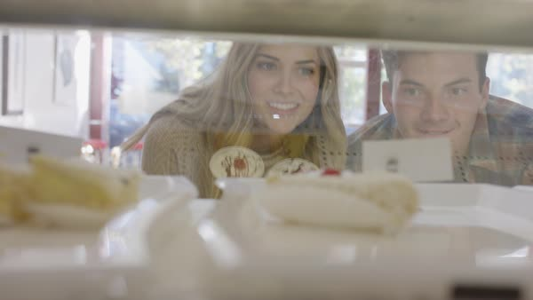 Close up shot of couple looking at bakery display case Royalty-free stock video