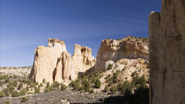 Wide flyover shot of rock formations in desert Royalty-free stock video