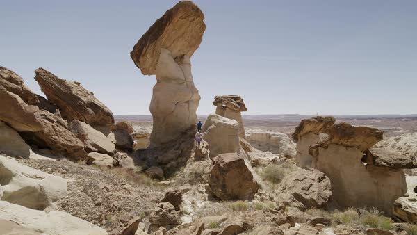 Wide shot of people hiking on unusual rock formations Royalty-free stock video