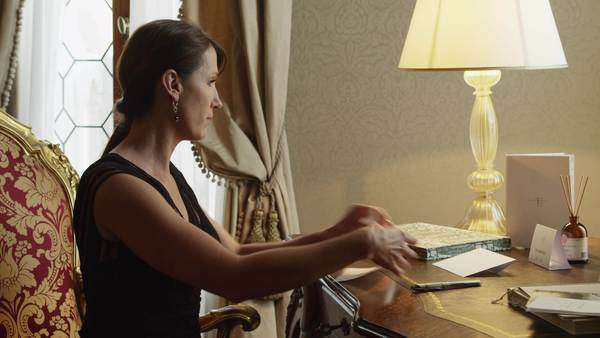 Medium shot of woman writing letter at antique desk, Venice, Italy Royalty-free stock video