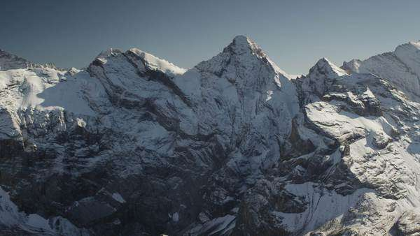 Wide shot of snow covered mountain, Schilthorn Piz Gloria, Switzerland Royalty-free stock video