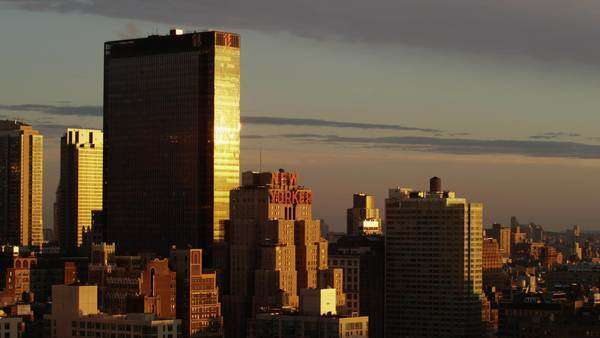 Wide shot of cityscape at sunset / New York City, New York, United States Royalty-free stock video