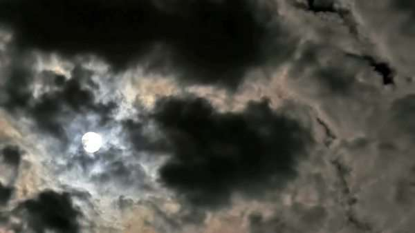 Fascinating iridescent clouds passing, backlit by the full moon. Timelapse. Royalty-free stock video