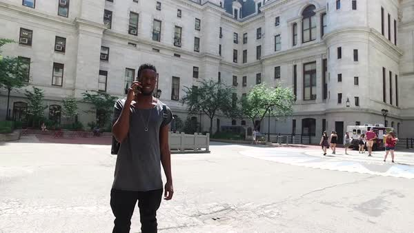 Medium shot of a man talking on his mobile phone at Philadelphia City Hall, PA, USA Royalty-free stock video