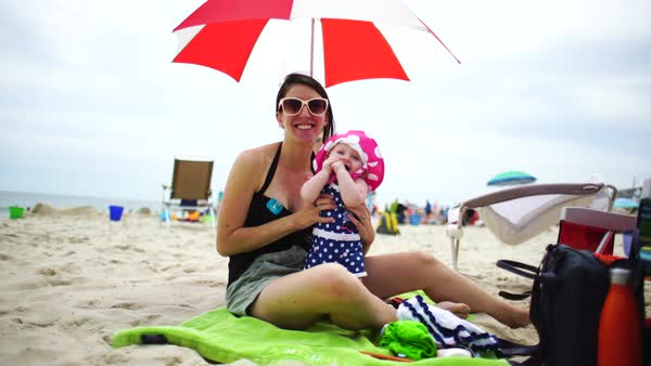 Hand-held medium shot of happy mother and baby on summer vacation Royalty-free stock video