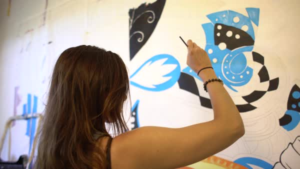 Hand-held shot of a woman painting in a studio Royalty-free stock video