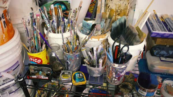 High-angle shot of paint brushes in buckets Royalty-free stock video
