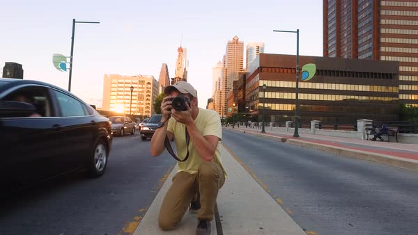 Push-in shot of a man taking photographs of traffic Royalty-free stock video