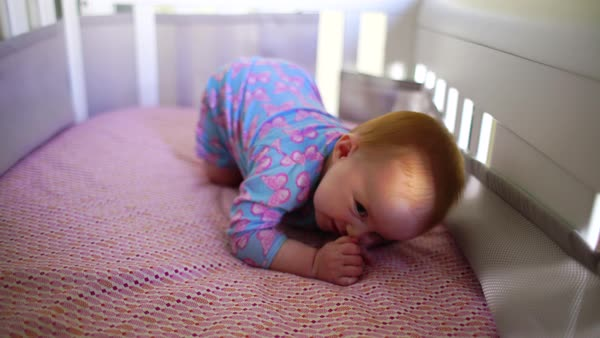 Hand-held shot of a baby lying in a crib Royalty-free stock video