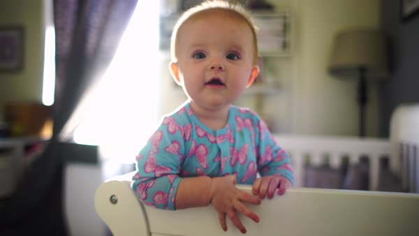 Hand-held shot of a baby standing in a crib Royalty-free stock video
