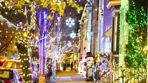 Tilt-down shot of a street decorated with Christmas lights Royalty-free stock video