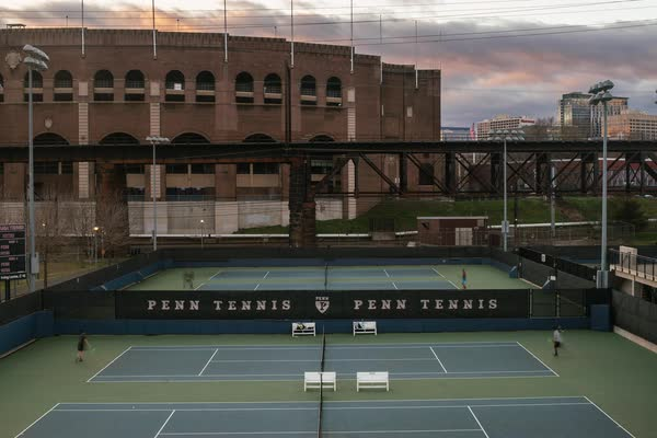Timelapse of people playing tennis at the Hamlin Tennis Courts at Penn Park Rights-managed stock video