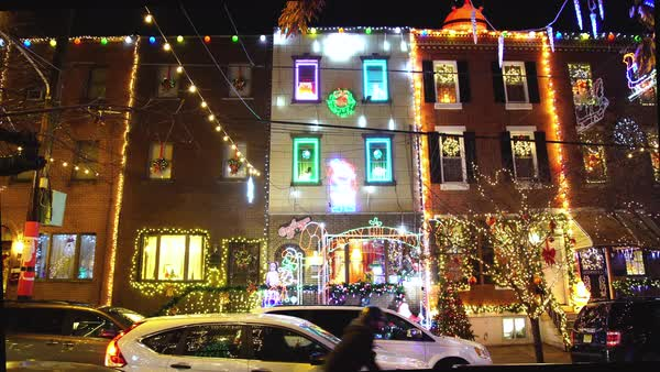 Gimbal shot of row houses with Christmas decorations Rights-managed stock video
