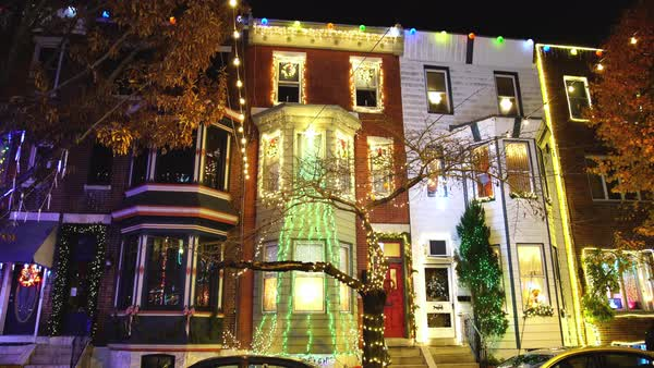 Tilt-up shot of row houses with Christmas decorations Rights-managed stock video