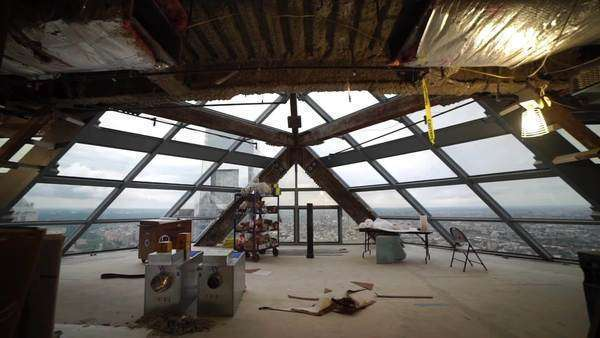 Dolly shot of room filled with windows displaying Philadelphia skyline and Comcast Center Rights-managed stock video