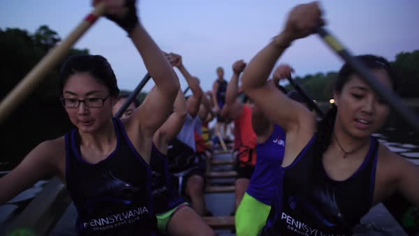 Medium shot of people rowing in a dragon boat Rights-managed stock video