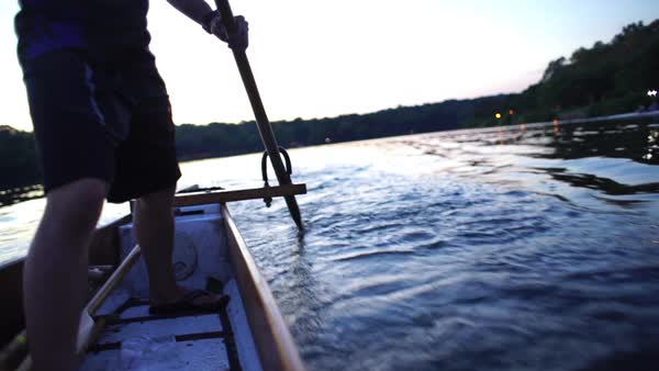 Medium shot of the steersman in a dragon boat Rights-managed stock video