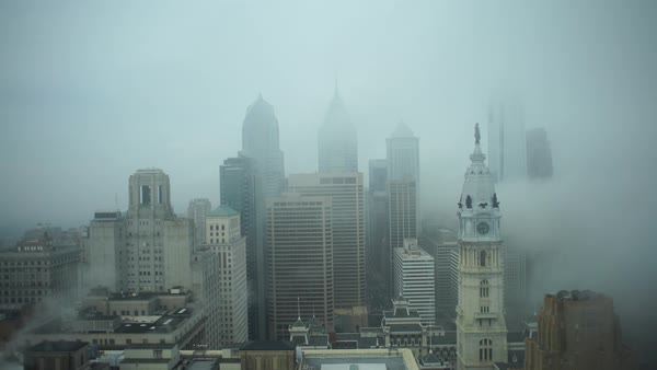Wide shot of Downtown Philadelphia shrouded in fog Rights-managed stock video